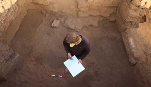 Mat Dalton (University of Cambridge) pondering deposits in E13.13 on Thursday, a multiphase room he has been excavating and recording since 2010