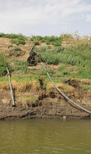 Diesel pump carrying water from the Nile up to the fields.