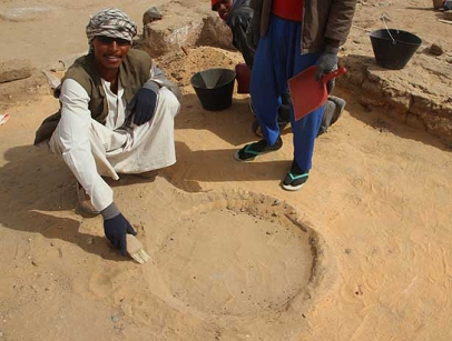 Workman Hafif Mohamed revealing an ancient hearth