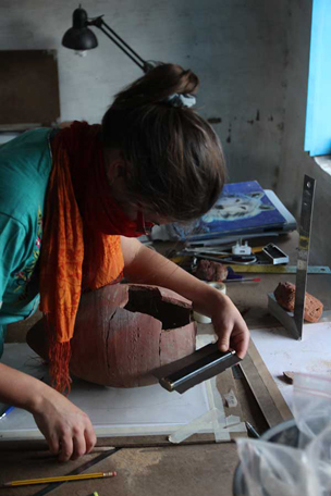 Loretta recording a pottery vessel from G244 in the work room