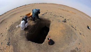 Removing spoil from G244, showing circular mound (tumulus)