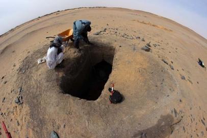 Removing spoil from G244, showing circular mound (tumulus)