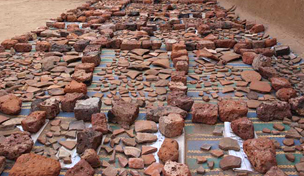 Washed pottery laid out to dry