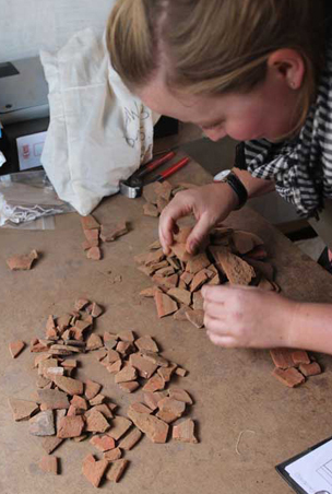 Sorting washed sherds to identify forms of original vessels