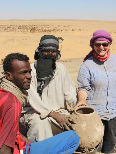 Occasional find of a complete pot in the town! Archaeologist Sarah Doherty,with excavators Miki Ali Hassan and Adli Mohamed.