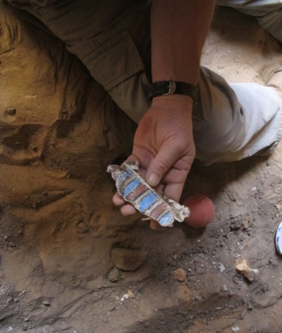 Philip Kevin lifting a particularly well preserved coffin fragment in G244