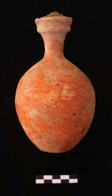 Miniature flask with the stopper originally sealing the vessel still intact