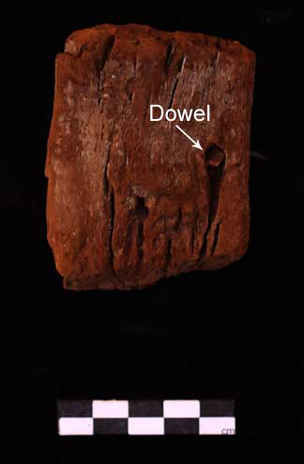 Fragment of wood with wooden dowel still in place