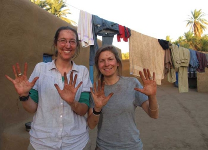 Emerging from the storeroom: Marie and Michaela after an afternoon sorting dusty old wood