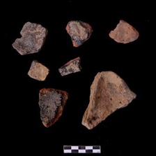 Fragments of pottery crucibles, with copper alloy deposits on interior
