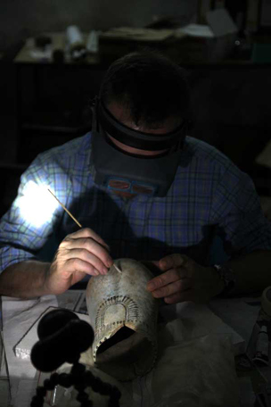 Philip back in the 'laboratory' of our dig house, reconstructing the situla