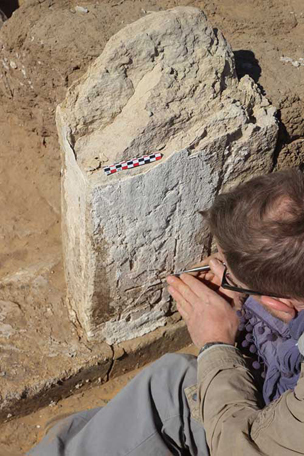 Philip 'on the town', revealing the inscription re-used in house E13.5