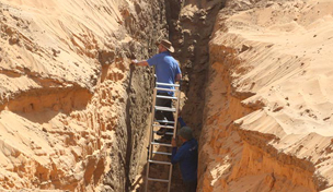studying deposits of windblown sand and Nile flood units in the palaeochannel adjacant to the town