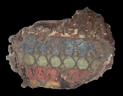 Fragment of painted plaster from the house of the High Priest Panehesy at Amarna, EA38839.