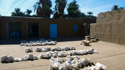 Linen bags filled with pottery in the dig house courtyard