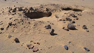 robbed chamber tomb at Amara West