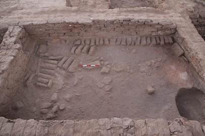 Rubble and brickwork revealed underneath house E13.16