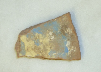 Ceramic sherd with blue and yellow pigment, probably a painting palette, from the magazine area E13.14