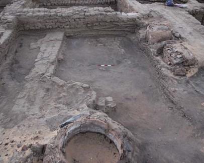 Early walls revealed alongside large ovens or kilns