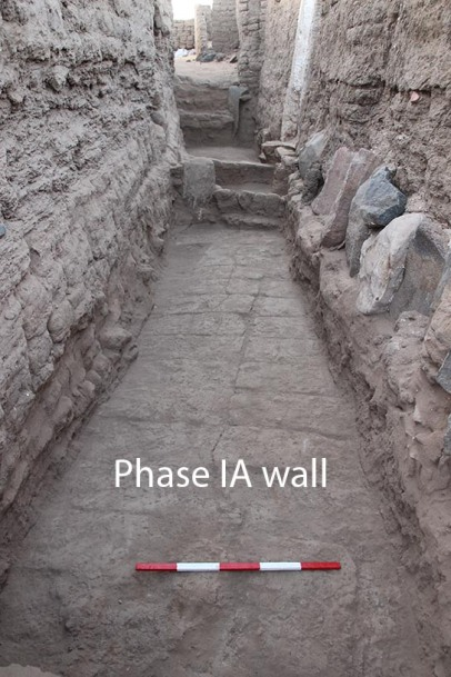 The Phase IA wall at base of later street E13.11. Note the stone revetment built against wall to right.