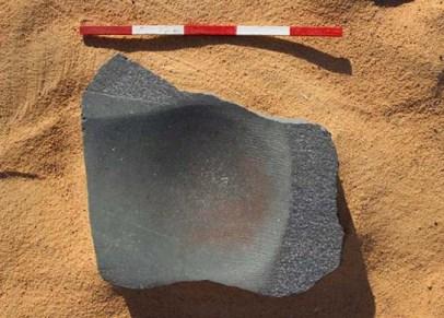 Hard schist grindstone, perhaps for quartz processing (F5901)