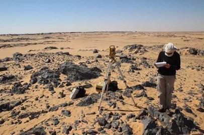 Delphine Driaux surveying in the desert north of Amara West