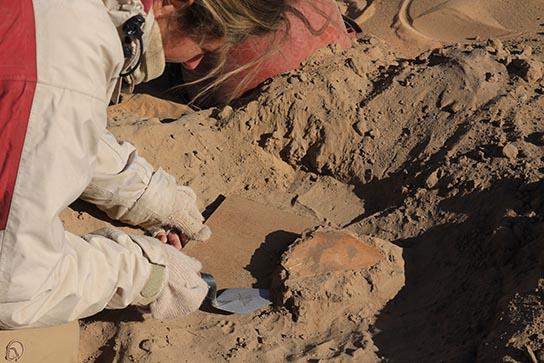 Manuela lifting the painted bone object