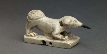 Figure of a dog with fish in mouth (ivory, bronze). Late 18th dynasty, c. 1350 BC. Egypt. British Museum EA 13596