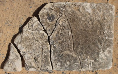 Sandstone lintel from the shaft of pyramid tomb G320, with frontal depiction of a figure with wig and beard.