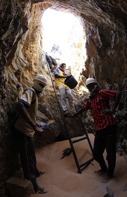 Taking a break from excavating down the shaft of tomb G320: Zahr Zuheir (left), Ahmed Ehab and Nayel Mohamed (on ladder)