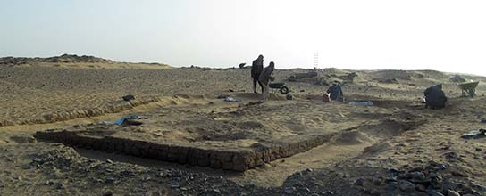 After a few hours of surface excavation, the pyramid base of tomb G322 is already visible