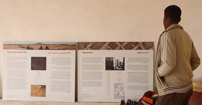 Haris Mohamed, one of our workmen, has a first look at the information panels in the Amara West visitor orientation area