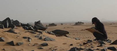Anna Stevens planning at desert site 2-R-19