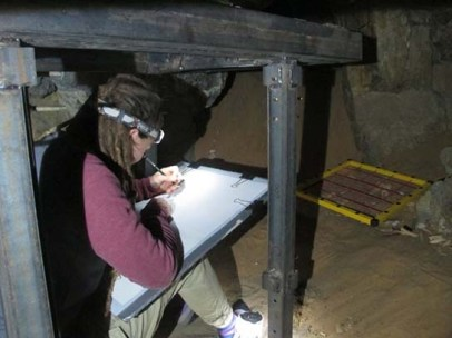Sofie drawing a skeleton under one of the steel protection tables installed in the chambers