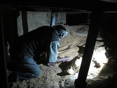 Mohamed excavating in the first burial chamber of G322