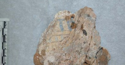 Painted plaster surface from coffin remains recovered from tomb G322