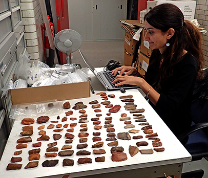 Nora studying the Amara West flints in the British Museum basement