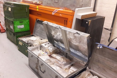Metal crates with samples, awaiting sorting