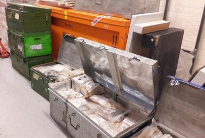 Metal crates with samples, awaiting sorting