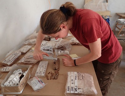 Manuela working with the wood fragments, seeking joins