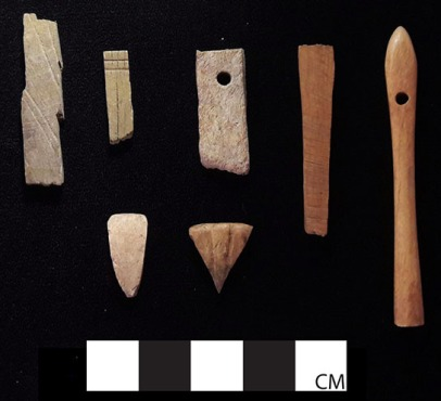 Bone and ivory fragments with worked and drilled surfaces